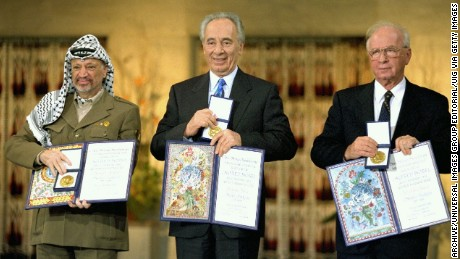 Photograph of Yitzhak Rabin, Shimon Peres and Yasser Arafat receiving the Nobel Peace Prize following the Oslo Accords. Dated 1994. (Photo by Universal History Archive/UIG via Getty Images)
