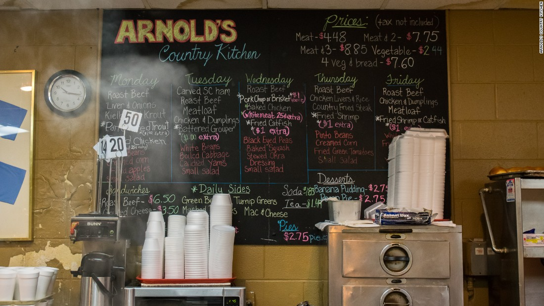 "At Arnold's Country Kitchen, a blackboard features the day's choices. One meat with three sides is the formula for Nashville's traditional ""meat-and-three"" meal."