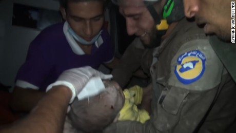 Syrian rescue worker sobs after rescuing baby from rubble