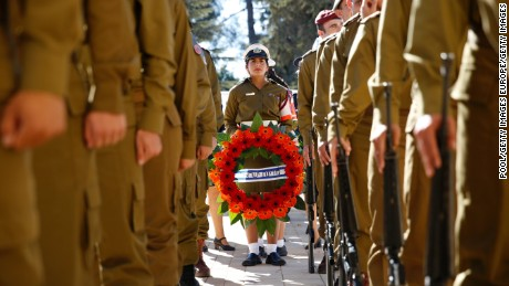 Israeli soldiers held wreaths during the funeral service.