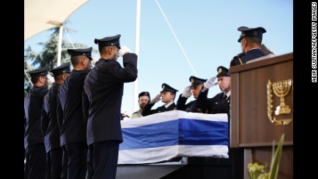 Knesset (Israel's parliament) guards salute as they place the coffin of former Israeli president Shimon Peres on a podium for his funeral on September 30, 2016, at Jerusalem's Mount Herzl national cemetery. World leaders including US President Barack Obama and Prince Charles were bidding farewell to Israeli ex-prime minister and Nobel Peace Prize winner Shimon Peres as his funeral began under massive security. / AFP / POOL / ABIR SULTAN        (Photo credit should read ABIR SULTAN/AFP/Getty Images)
