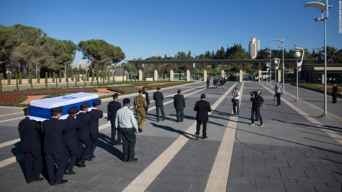 """Guards carry the coffin of former Israeli President Shimon Peres to Mount Herzl, Israel's national cemetery, on Friday, September 30. Peres, who shared a Nobel Prize for forging a peace deal between Israelis and Palestinians, <a href=""""http://www.cnn.com/2016/09/27/middleeast/shimon-peres-obit/"""" target=""""_blank"""">died Wednesday</a> at the age of 93."""