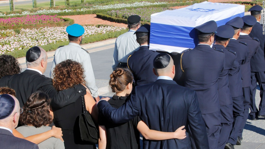 Family members walk behind Peres' coffin at the start of his funeral procession on September 30.