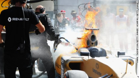 The car of Kevin Magnussencatches fire during practice for the Malaysian Grand Prix.