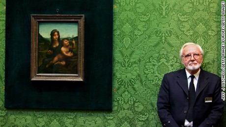 """Joe Hay, security guard at the National Gallery of Scotland, stands beside the Leonardo da Vinci painting """"Madonna Of The Yarnwinder"""""""