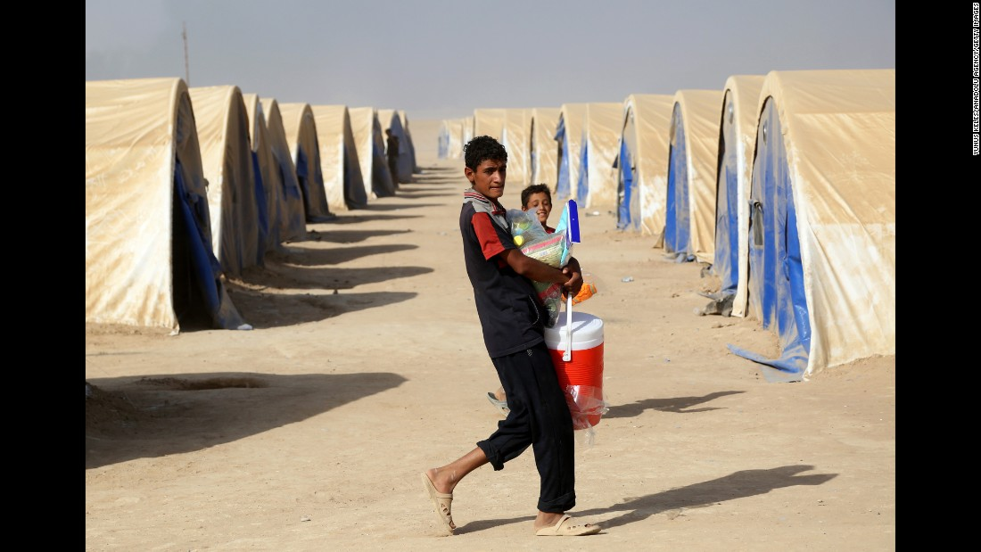 Iraqis displaced from ISIS-controlled towns and villages take shelter at this camp in Qayyarah, a few miles south of Mosul. Aid workers warn an assault on Mosul could trigger an exodus of catastrophic dimensions.
