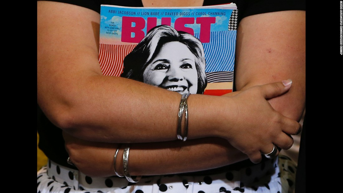 A woman holds a magazine with Hillary Clinton on the cover before the presidential candidate appeared at a campaign event in Durham, New Hampshire, on Wednesday, September 28.