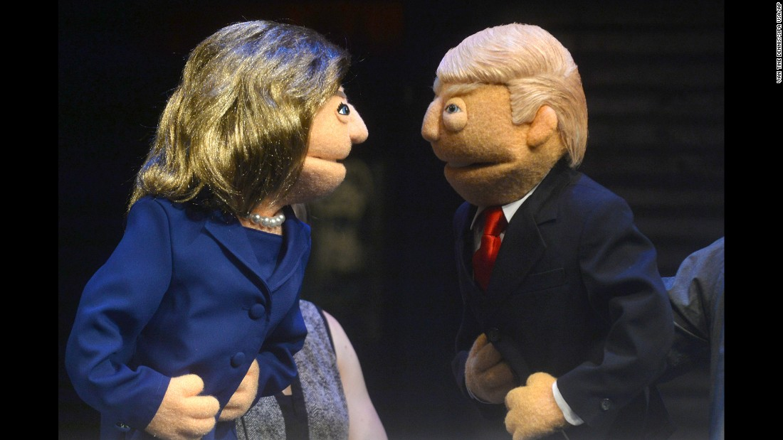 Puppets of Hillary Clinton and Donald Trump face off in a town-hall event in New York on Monday, September 26.