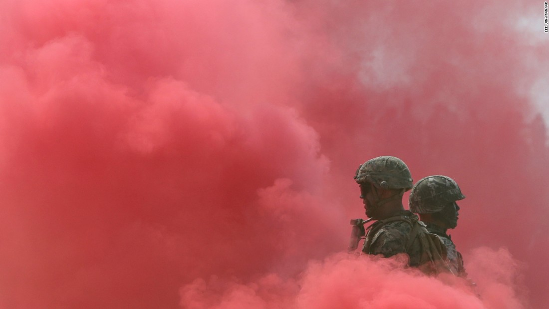 A U.S. Marine and a South Korean Marine stand in smoke during a ceremony in Incheon, South Korea, on Friday, September 9. The ceremony was commemorating the Battle of Incheon, a turning point in the Korean War.