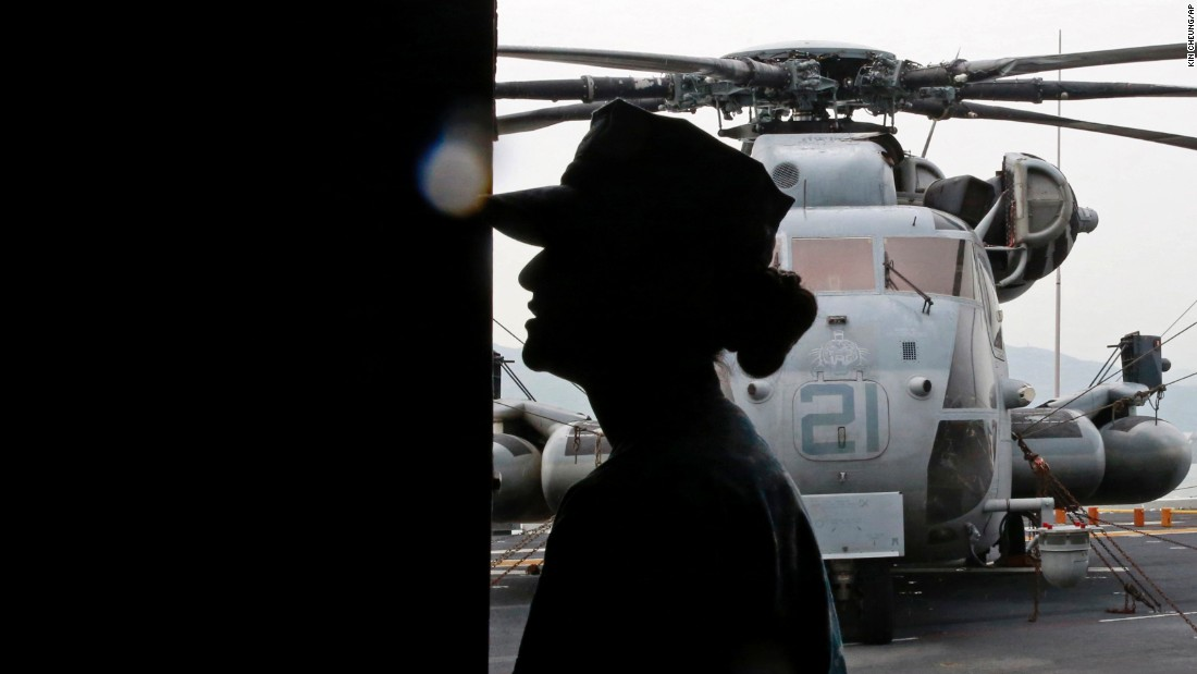 A U.S. Marine is silhouetted on the deck of the USS Bonhomme Richard on Thursday, September 29.