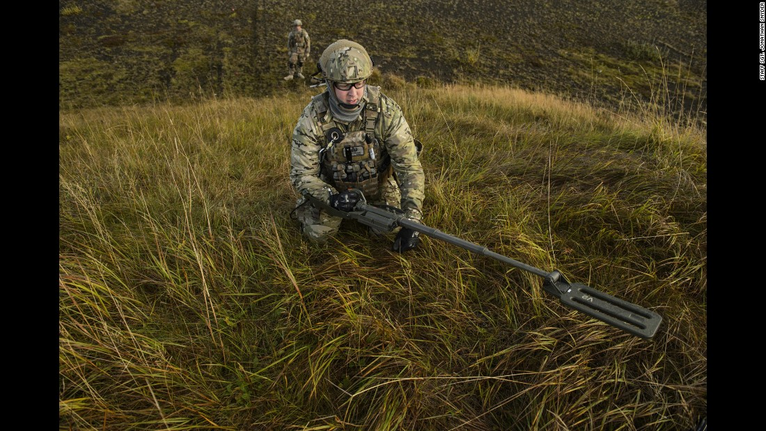 Air Force Tech. Sgt. Jason Umlauf uses a mine detector during a training exercise in Keflavik, Iceland, on Monday, September 19.