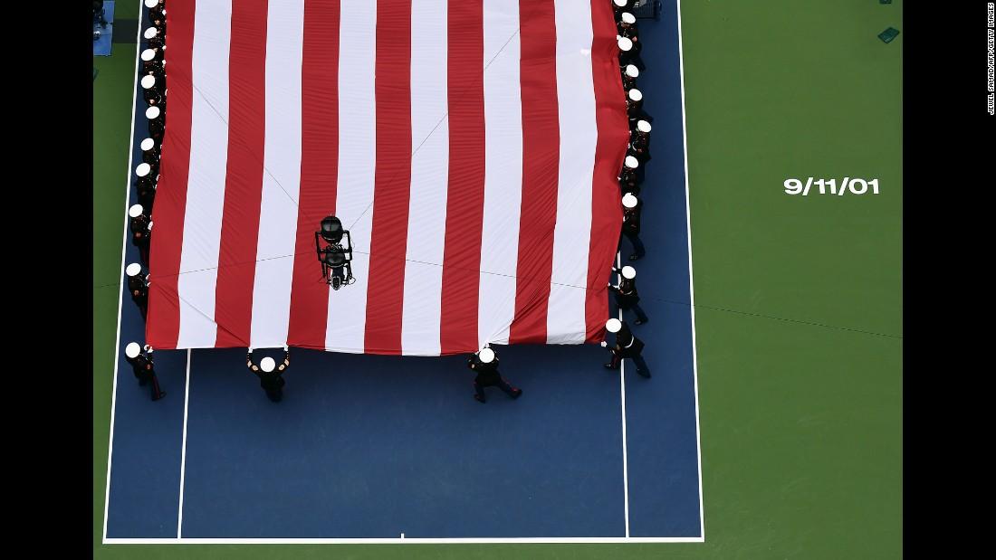 U.S. Marines unfurl a large American flag across New York's Arthur Ashe Stadium before the U.S. Open women's final on Saturday, September 10.