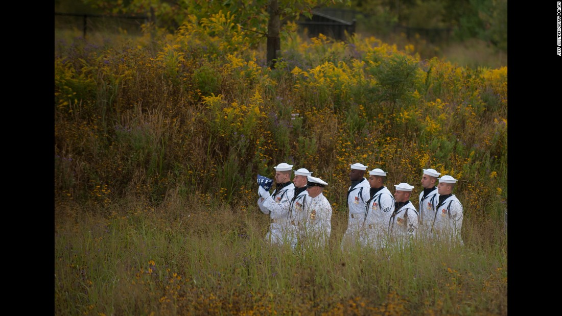 """A U.S. Navy honor guard walks with a flag to the Wall of Names at the Flight 93 National Memorial in Shanksville, Pennsylvania, on Sunday, September 11. <a href=""""http://www.cnn.com/2016/09/11/us/gallery/911-15th-anniversary/index.html"""" target=""""_blank"""">See more memorials from the 15th anniversary of the 9/11 attacks</a>"""