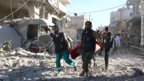 TOPSHOT - Syrian volunteers carry an injured person on a stretcher following Syrian government forces airstrikes on the rebel held neighbourhood of Heluk in Aleppo, on September 30, 2016. Syrian regime forces advanced in the battleground city of Aleppo, backed by a Russian air campaign that a monitor said has killed more than 3,800 civilians in the past year. / AFP / THAER MOHAMMED        (Photo credit should read THAER MOHAMMED/AFP/Getty Images)