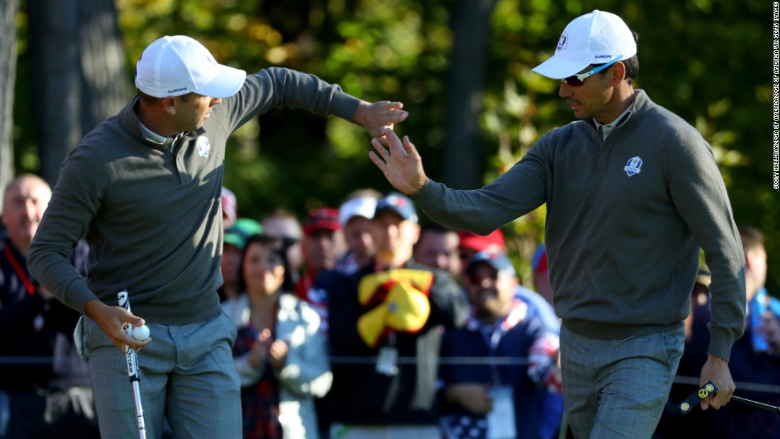 Sergio Garcia and Rafa Cabrera Bello of Europe react to a putt on the 5th green.