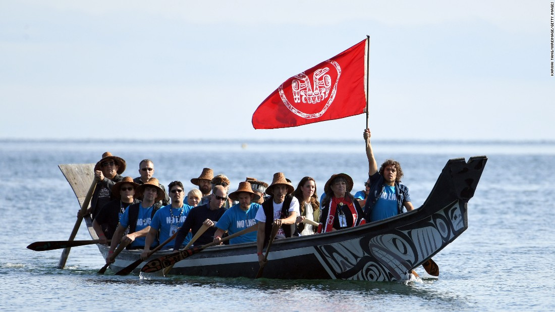 William, Catherine and others arrive at the Haida Heritage Centre and Museum in a traditional boat on September 30 in Haida Gwaii, British Columbia, Canada.