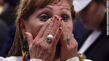 A woman cries after knowing the result of a referendum vote to ratify a historic peace accord to end a 52-year war between the state and the communist FARC rebels, in Bogota on October 2. Colombian voters rejected a peace deal with communist FARC rebels Sunday, near-complete referendum results indicated, blasting away what the government hoped would be a historic end to a 52-year conflict.