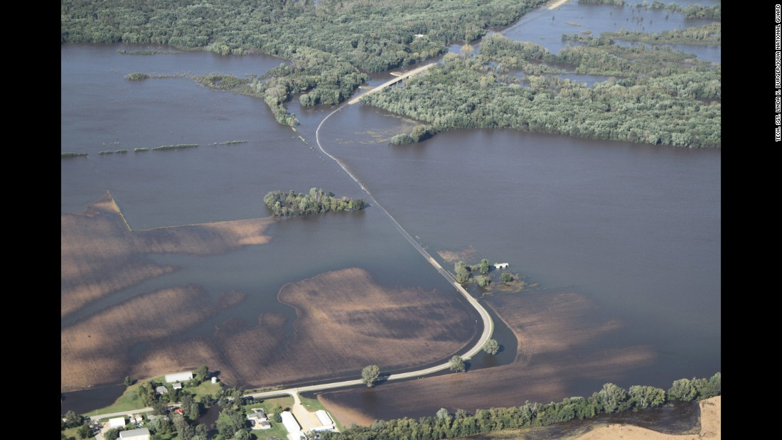 """In eastern Iowa, rising rivers and creeks <a href=""""http://www.cnn.com/2016/09/27/us/iowa-wisconsin-flooding/"""" target=""""_blank"""">flooded low-lying fields and properties</a> on Monday, September 26."""