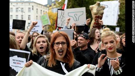 Polish women take part in a nationwide strike and demonstration to protest against a legislative proposal for a total ban of abortion on October 3, 2016 in Warsaw.