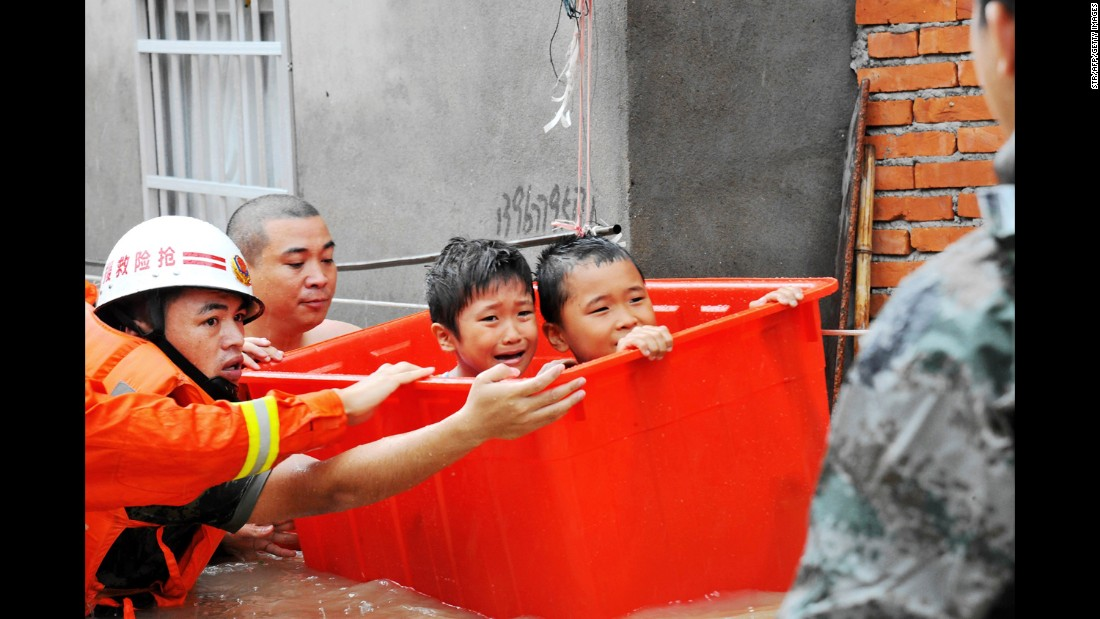 """Rescuers help flood-affected residents in Ningde, China, after <a href=""""http://www.cnn.com/2016/09/26/asia/typhoon-megi-taiwan-weather/"""" target=""""_blank"""">Typhoon Megi</a> made landfall on Tuesday, September 28."""
