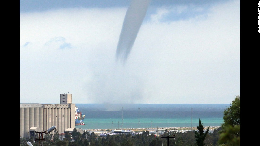 A waterspout passes near a beach in Turkey's Hatay Province on Friday, September 23.