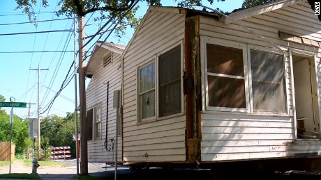 A moving company left this house in the middle of an Austin, Texas, street after it became too difficult to try and move it any farther.