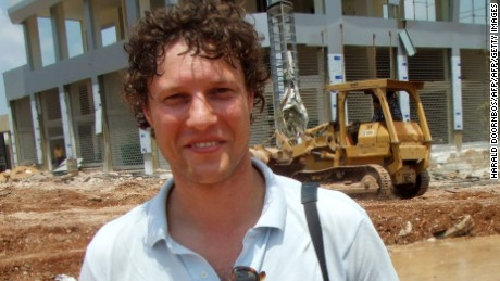 "This picture taken on July 14, 2006 shows Dutch Journalist Jeroen Oerlemans posing for a photograph while on assignment in Beirut.    A Dutch journalist was killed by sniper fire on October 2, 2016 while covering clashes in Libya's coastal city of Sirte, as unity government forces battled Islamic State group holdouts in the jihadist bastion.Dr Akram Gliwan, spokesman for a hospital in Misrata where pro-government fighters are treated, told AFP that photographer Jeroen Oerlemans was ""shot in the chest by an IS sniper while covering battles in Sirte"" 450 kilometres (280 miles) east of Tripoli.  / AFP PHOTO / ANP / HARALD DOORNBOS / Netherlands OUTHARALD DOORNBOS/AFP/Getty Images"
