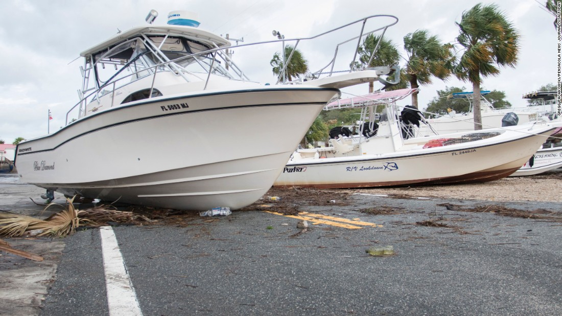 """Boats rest in the middle of a road in Steinhatchee, Florida, after <a href=""""http://www.cnn.com/2016/09/01/weather/tropical-storm-hermine/"""" target=""""_blank"""">Hurricane Hermine made landfall</a> on Friday, September 2."""