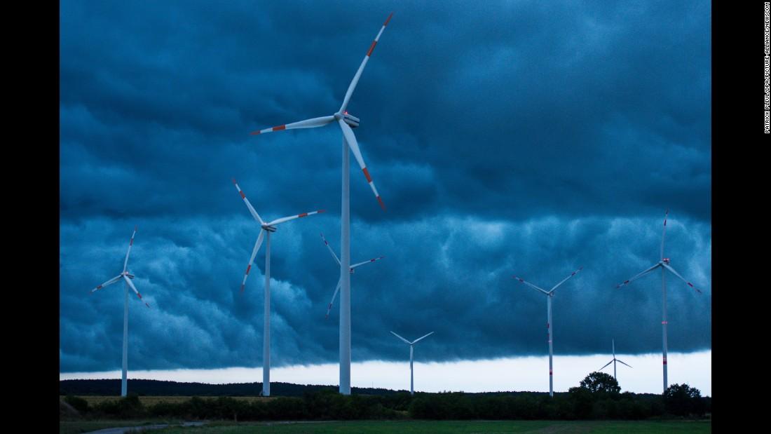 Storm clouds develop near wind turbines in Sieversdorf, Germany, on Sunday, September 4.