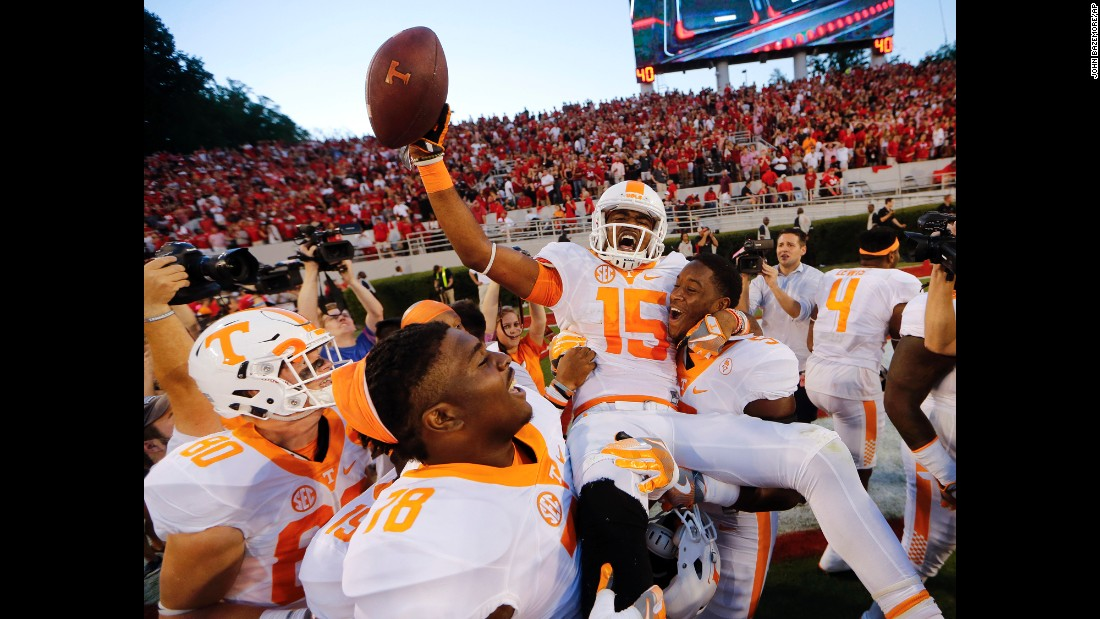 """Tennessee wide receiver Jauan Jennings is carried by his teammates after <a href=""""http://bleacherreport.com/articles/2667024-tennessee-stuns-georgia-with-game-winning-hail-mary"""" target=""""_blank"""">catching a Hail Mary pass</a> to win at Georgia on Saturday, October 1. Jennings' amazing catch came just seconds after Georgia hit a long touchdown pass of its own."""