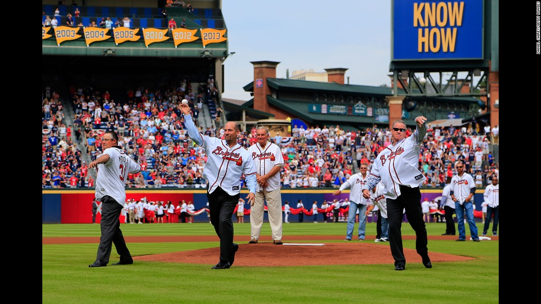 Three Hall of Fame pitchers -- from left, Greg Maddux, John Smoltz and Tom Glavine -- throw out the first pitch before an Atlanta Braves game on Sunday, October 2. It was the final Braves game at Turner Field; the team is moving to a new ballpark next year.