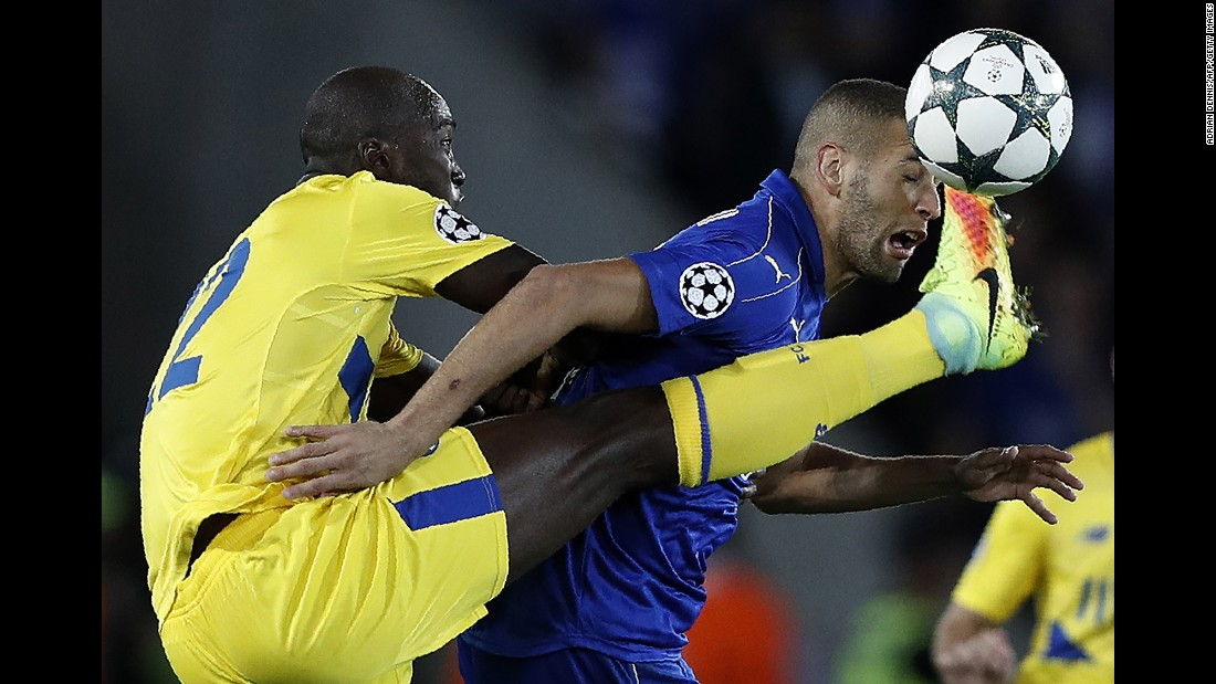 Porto midfielder Danilo, left, competes for the ball with Leicester City striker Islam Slimani during a Champions League match in Leicester, England, on Tuesday, September 27. Danilo received a yellow card for the challenge.