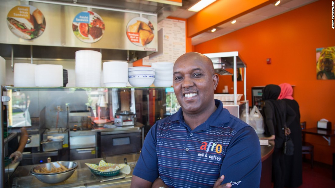 """Abdirahman Kahin, owner of Afro Deli restaurant in Minneapolis. Came to the U.S. from Somalia in the 1990s. Leans Democrat and is supporting Hillary Clinton. <br /><br />""""We feel like we're double victims because number one, because as Americans we been affected by what happened, 9/11 because what these guys did. This affected me as an American. At the same time, other Americans see us as traitors."""""""