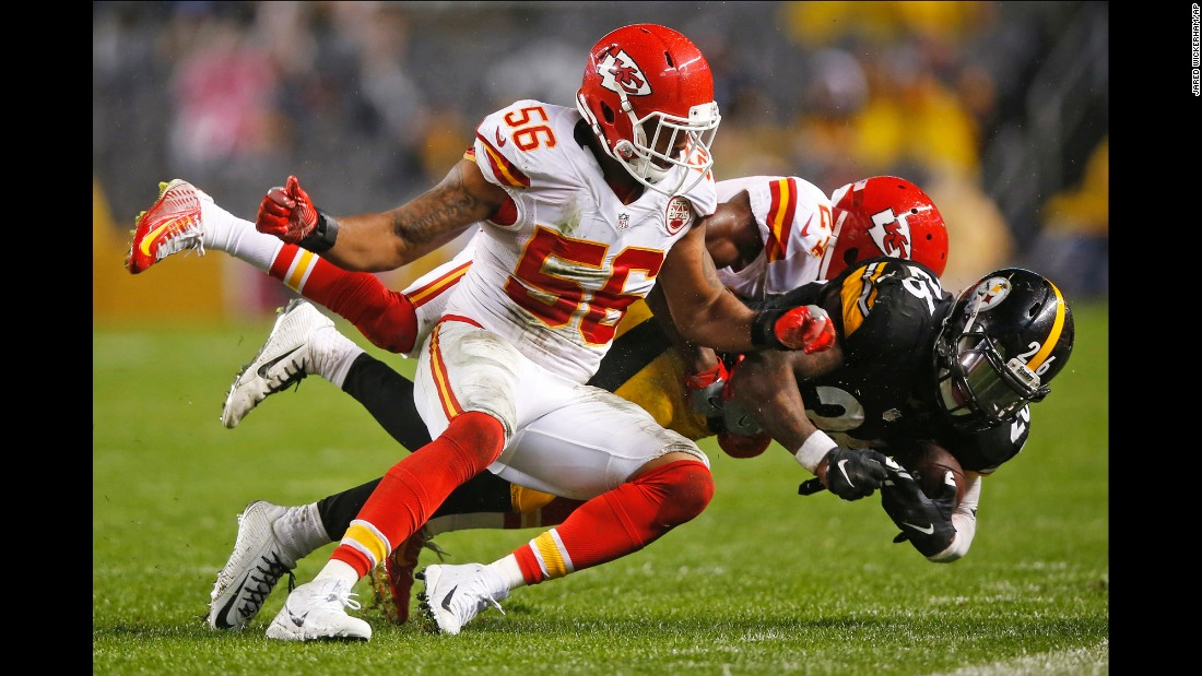 Pittsburgh running back Le'Veon Bell is tackled by two Kansas City Chiefs during an NFL game in Pittsburgh on Sunday, October 2. Bell rushed for 144 yards in his first game back from a three-game suspension, and the Steelers won 43-14.