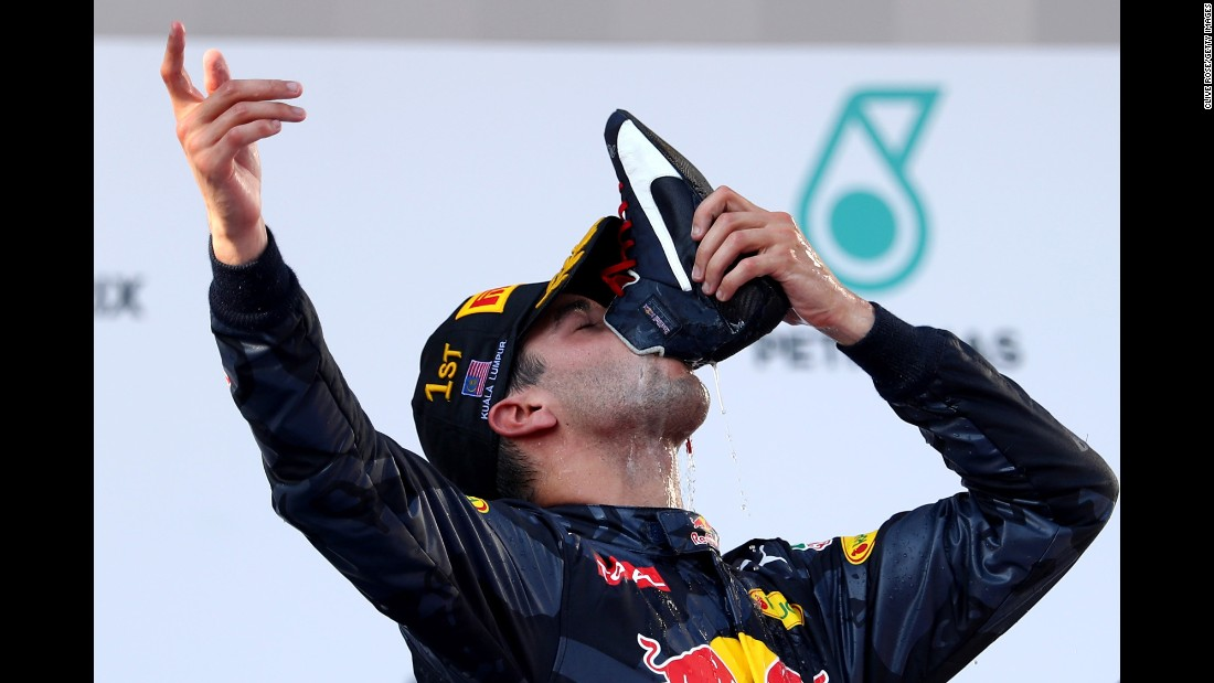 """Formula One driver Daniel Ricciardo drinks from his boot as he celebrates victory in the <a href=""""http://www.cnn.com/2016/10/02/motorsport/malaysia-gp/index.html"""" target=""""_blank"""">Malaysian Grand Prix</a> on Sunday, October 2."""