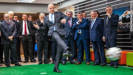 TOPSHOT - FIFA's President Gianni Infantino kicks a football during an event at the Sergio Arboleda University in Bogota, on October 3, 2016. Infantino arrived in Colombia to attend the final of the final of the Colombia 2016 FIFA Futsal World Cup on October 1.   / AFP / Jose Miguel GOMEZ        (Photo credit should read JOSE MIGUEL GOMEZ/AFP/Getty Images)