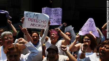 Women demonstrate in favour of abortion as the Supreme Court debates on whether to declare unconstitutional certain points of an abortion law which would open a loophole for its gradual decriminalization across the country, in front of the Supreme Court in Mexico City on June 29, 2016. Mexico's Supreme Court debates whether to decriminalize abortion, currently only authorized in Mexico City before 12 weeks of gestation, in the world's second biggest Catholic country. / AFP / Hector GUERRERO        (Photo credit should read HECTOR GUERRERO/AFP/Getty Images)