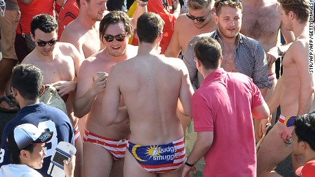 Spectators with swimwear bearing a Malaysian flag during the Formula One Malaysian Grand Prix in Sepang on October 2.