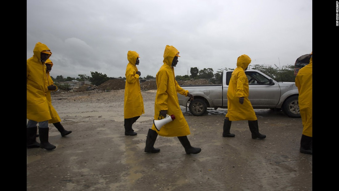 Haitian civil protection workers arrive to evacuate the Tabarre region of Haiti on October 3.