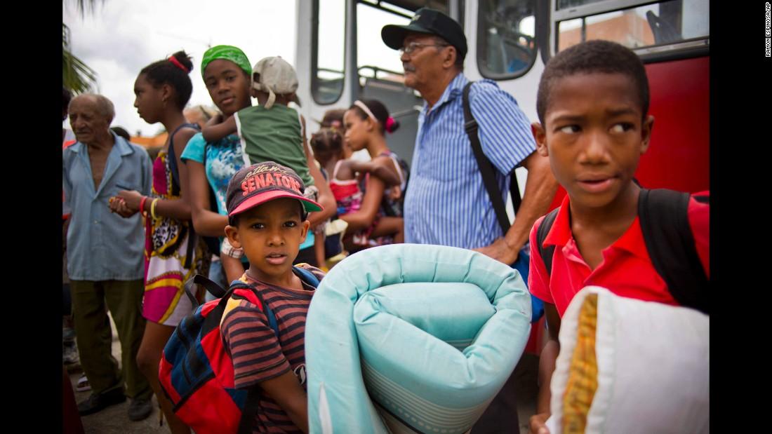 Families seek shelter from Hurricane Matthew at a university facility in Guantanamo, Cuba.
