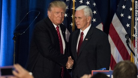 "Donald Trump, 2016 Republican presidential nominee, left, shakes hands with Mike Pence, 2016 Republican vice presidential nominee, during a campaign event at Youngstown State University in Youngstown, Ohio, U.S., on Monday, Aug. 15, 2016. Trump's plan to prevent terrorist attacks on American soil includes a screening test meant to allow entrance only to immigrants ""who we expect to flourish in our country."" Photographer: Ty Wright/Bloomberg via Getty Images"