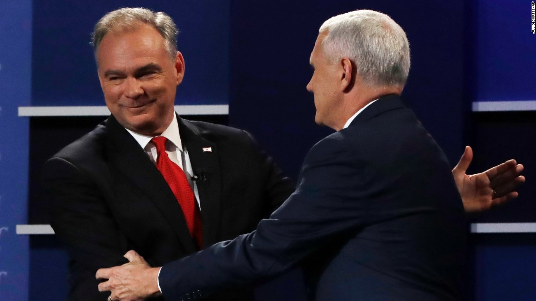 U.S. Sen. Tim Kaine, left, shakes hands with Indiana Gov. Mike Pence after the vice presidential debate in Farmville, Virginia, on Tuesday, October 4. Kaine is the running mate to Democratic nominee Hillary Clinton. Pence is on the ticket with Republican nominee Donald Trump.