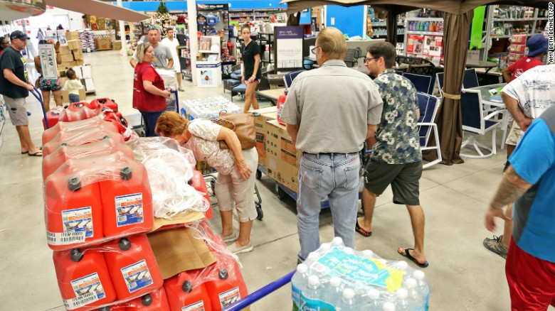 Shoppers look for items amid the generators, cases of water and gas cans at Lowe's in Oakland Park, Florida, on Tuesday, October 4, 2016.