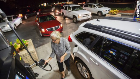 Gayle Brown fills up her car after waiting in line at a Sunoco gas station in Mt. Pleasant, S.C., Tuesday, October 4, 2016 in advance of Hurricane Matthew which is expected to affect the South Carolina coast by the weekend.
