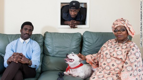 G.B. England. 2014. New British. Joe Arojojoye, his mother Adebimpe Ogunmokun and brother Michael Ashaolu. From Nigeria.