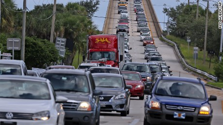 Cars crammed roads as people fled evacuation zones in Florida as Hurricane Matthew approached.