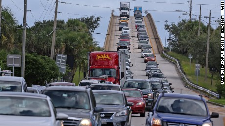 People in vehicles take an evacuation route on Wednesday, October 5 over state road 520 heading west from Merritt Island, Florida. Preparations have begun to evacuate Florida's coastal communities as Hurricane Matthew becomes a threat.