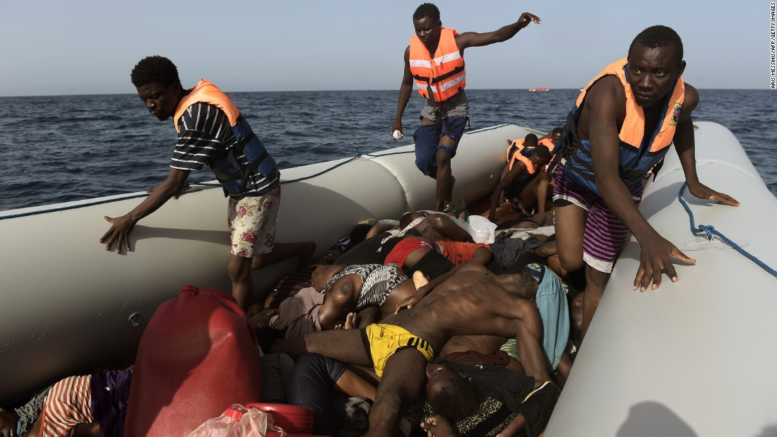 Migrants step over dead bodies while being rescued in the Mediterranean Sea.
