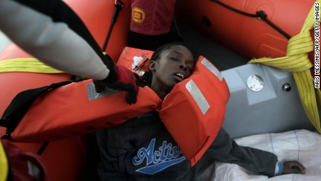 A woman faints after being rescued.