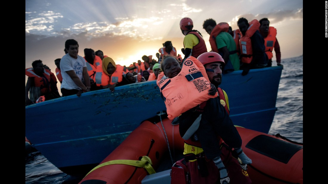 A child is rescued by a member of Proactiva Open Arms.